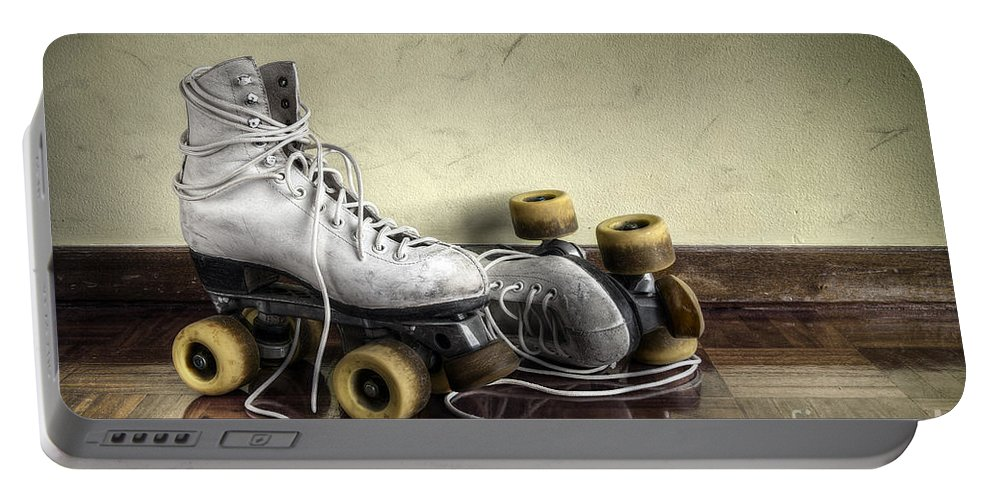 Active Portable Battery Charger featuring the photograph Vintage Roller Skates by Carlos Caetano