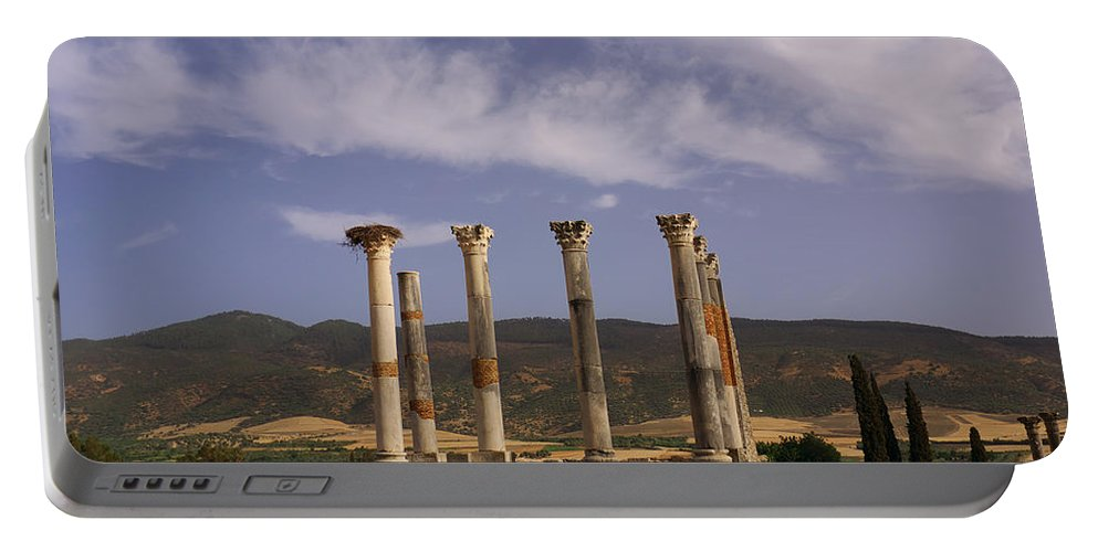 Capitol Portable Battery Charger featuring the photograph Volubilis Capitol by Ivan Slosar