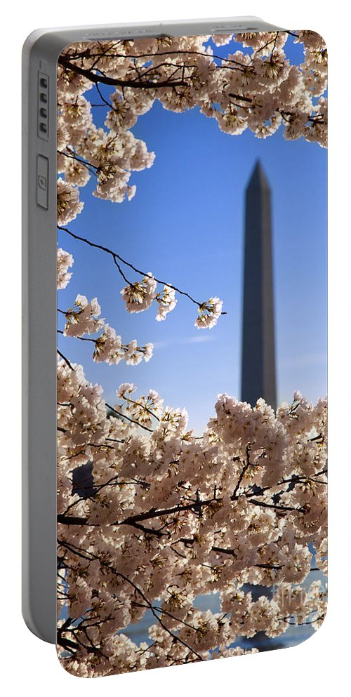 George Washington Portable Battery Charger featuring the photograph Washington Monument Cherry Trees by Brian Jannsen
