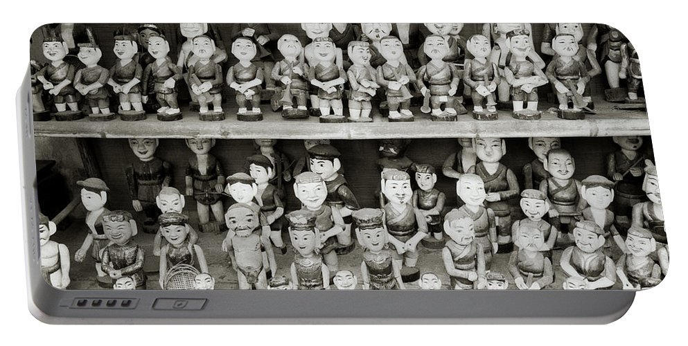 Asia Portable Battery Charger featuring the photograph Water Puppets by Shaun Higson