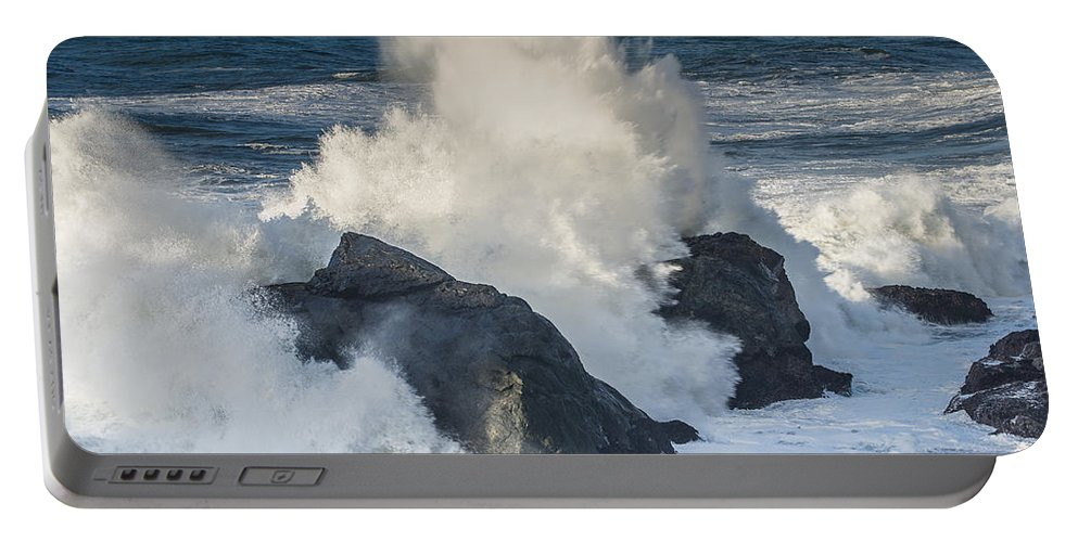 Surf Portable Battery Charger featuring the photograph Wave Meets Seastack by Greg Nyquist