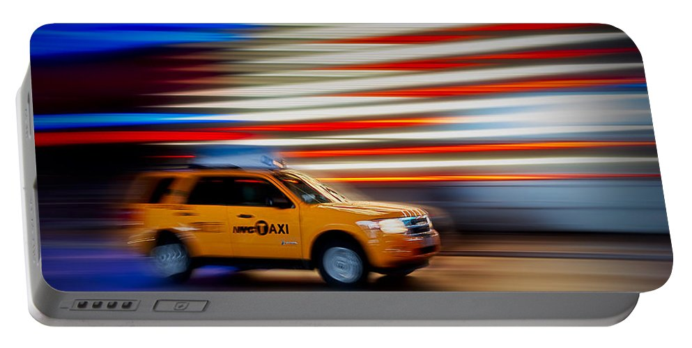 New York City Taxi Portable Battery Charger featuring the photograph Whizzing Along by Susan Candelario