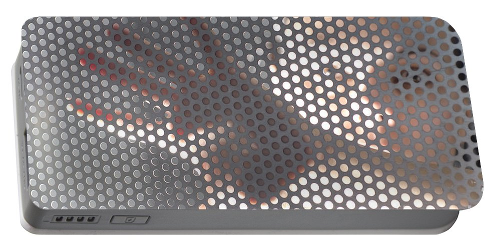 Hand Portable Battery Charger featuring the photograph Woman Behind A Metal Mesh by Mats Silvan