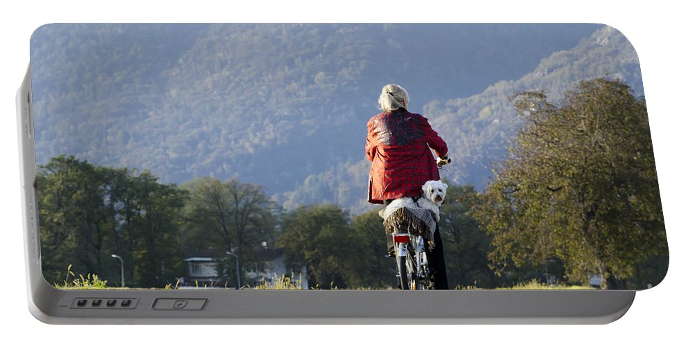 Woman Portable Battery Charger featuring the photograph Woman On A Bicycle With Her Dog by Mats Silvan
