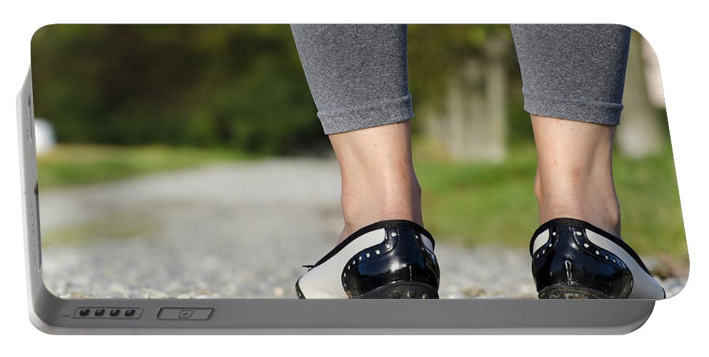 Woman Portable Battery Charger featuring the photograph Woman Standing On A Stone Road by Mats Silvan