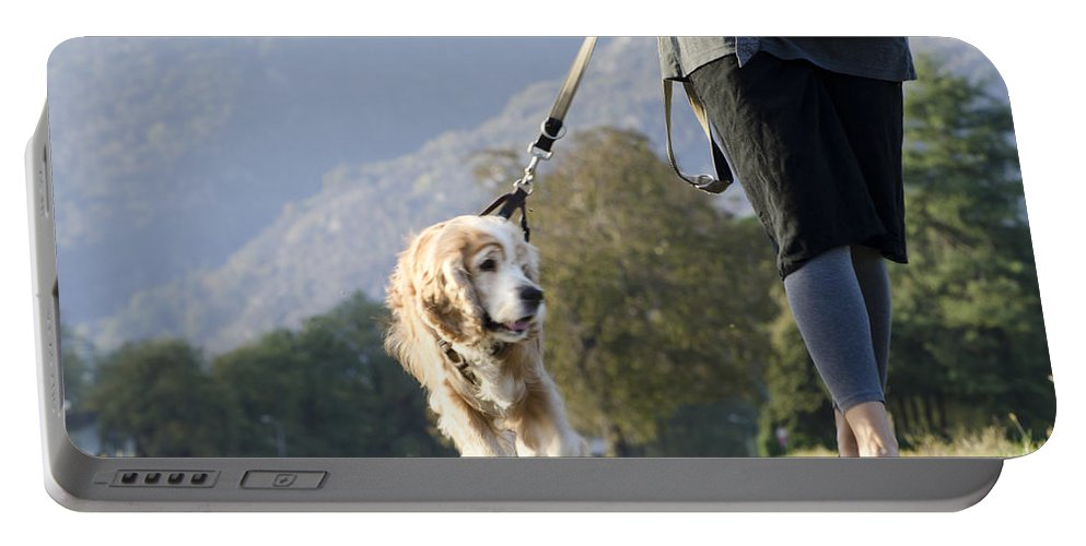 Woman Portable Battery Charger featuring the photograph Woman Walking With Her Dog by Mats Silvan