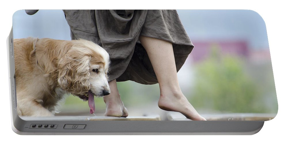 Shoes Portable Battery Charger featuring the photograph Woman With A Skirt And A Dog by Mats Silvan