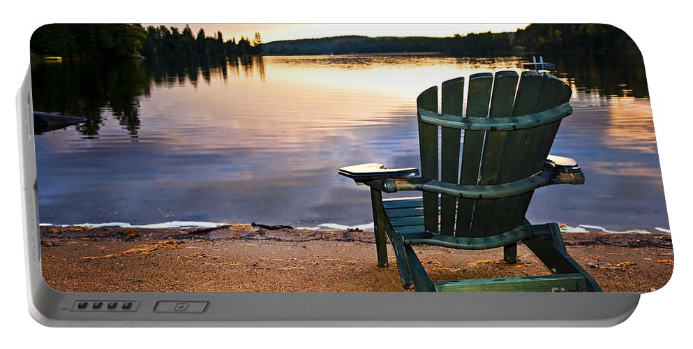 Lake Portable Battery Charger featuring the photograph Wooden Chair At Sunset On Beach by Elena Elisseeva