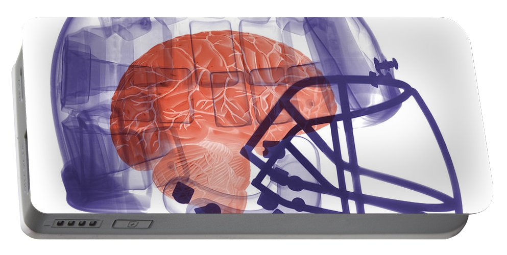 Football Helmet Portable Battery Charger featuring the photograph X-ray Of Head In Football Helmet by Ted Kinsman