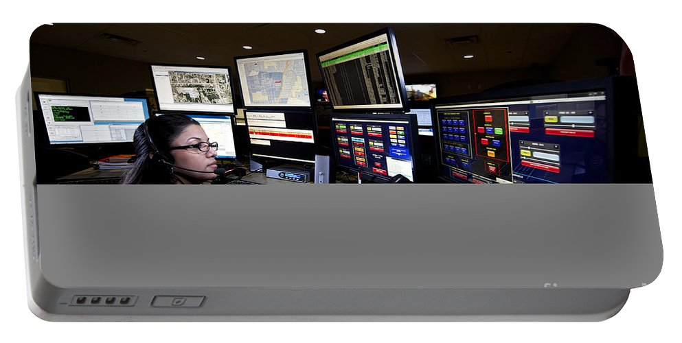 Call Center Portable Battery Charger featuring the photograph Young Woman Working In The Emergency by Terry Moore