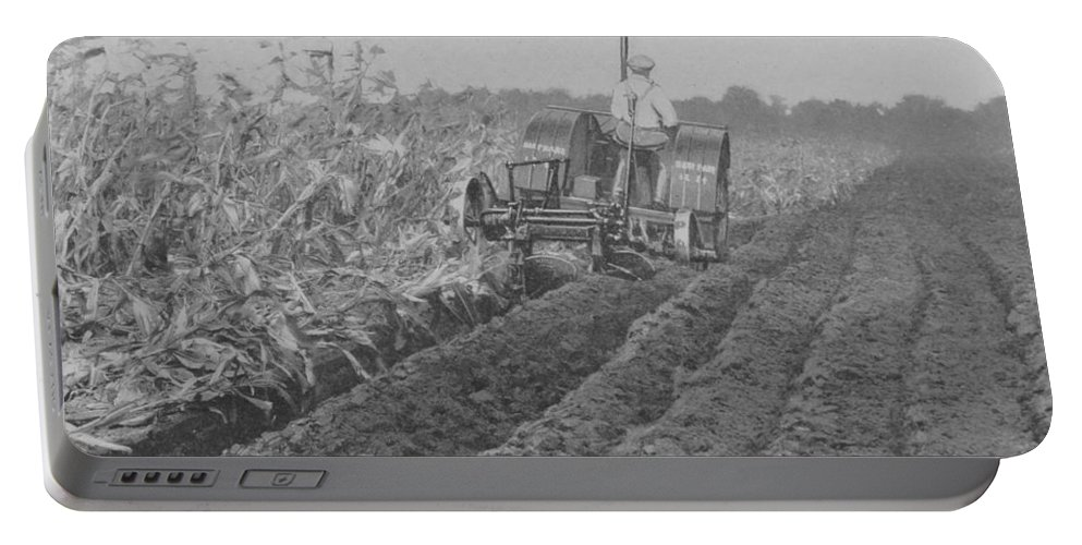 Farm Portable Battery Charger featuring the photograph A Farmer Driving A Tractor by American School