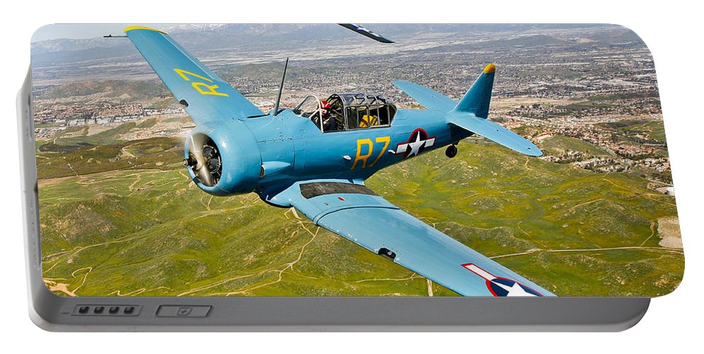 Square Image Portable Battery Charger featuring the photograph A T-6 Texan And P-51d Mustang In Flight by Scott Germain