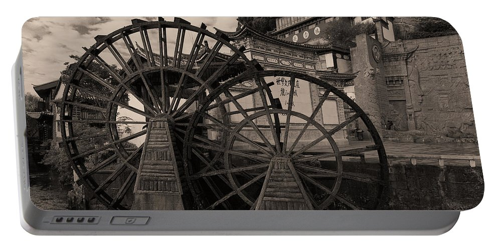 Asia Portable Battery Charger featuring the photograph Ancient Chinese Waterwheels by Michele Burgess