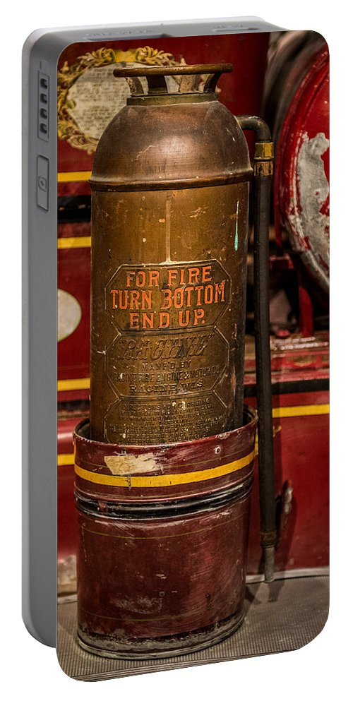Antique Fire Extinguisher Portable Battery Charger featuring the photograph Antique Fire Extinguisher by Paul Freidlund