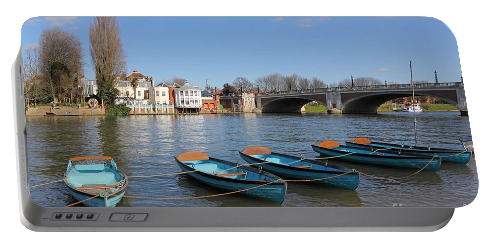 Blue Rowing Boats On The Thames At Hampton Court London Portable Battery Charger featuring the photograph Blue Rowing Boats On The Thames At Hampton Court London by Julia Gavin