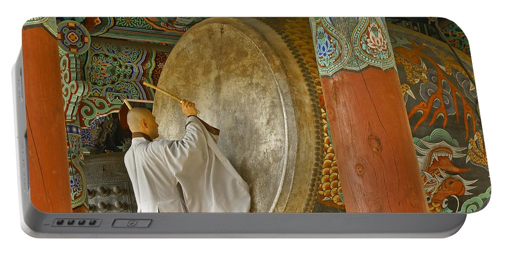Asia Portable Battery Charger featuring the photograph Buddhist Monk Drumming by Michele Burgess