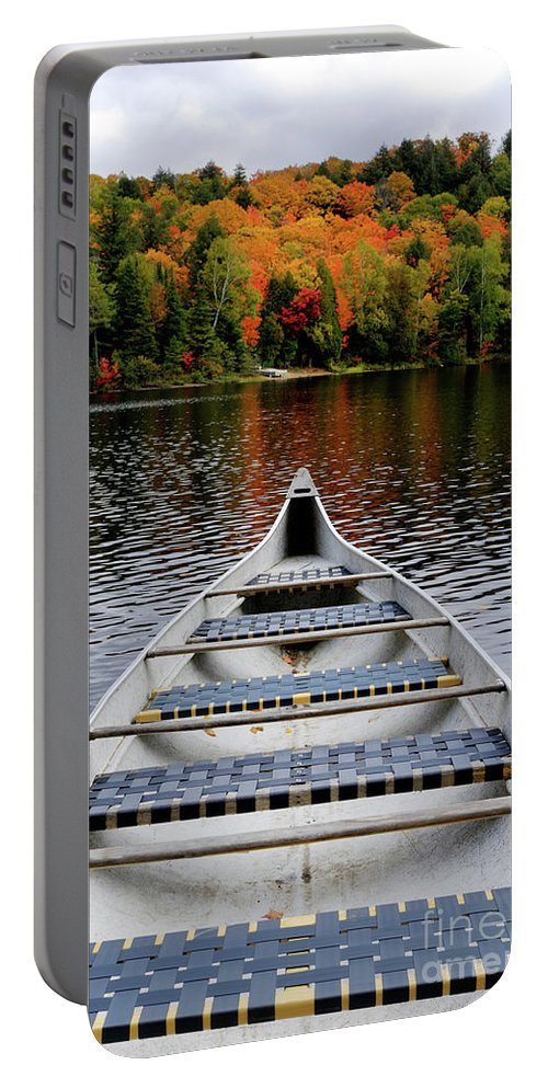 Canoe Portable Battery Charger featuring the photograph Canoe On A Lake by Maxim Images Prints