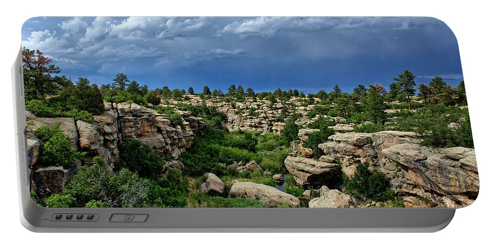 Castlewood Portable Battery Charger featuring the photograph Castlewood Canyon And Rain by Timothy Ruf