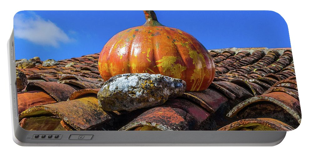 Ceramic Portable Battery Charger featuring the photograph Ceramic Pumpkin On A Roof by Jose Coelho