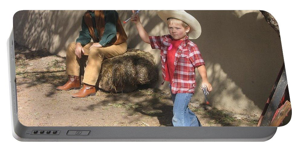 Junior Gunslinger With Doting Dad O.k. Corral Gunfight Site Tombstone Arizona 2004 Portable Battery Charger featuring the photograph Junior Gunslinger With Doting Dad O.k. Corral Gunfight Site Tombstone Arizona 2004 by David Lee Guss