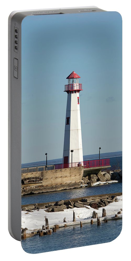 Wawatam Lighthouse Portable Battery Charger featuring the photograph Light On The Water by Linda Kerkau