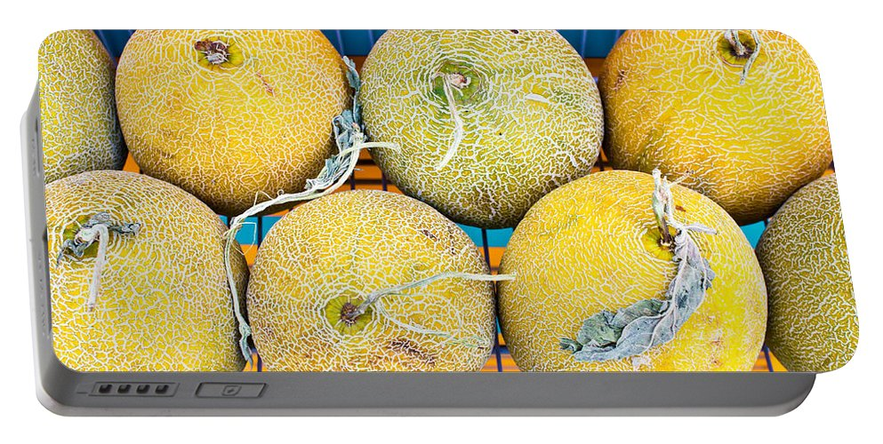 Background Portable Battery Charger featuring the photograph Melons by Tom Gowanlock