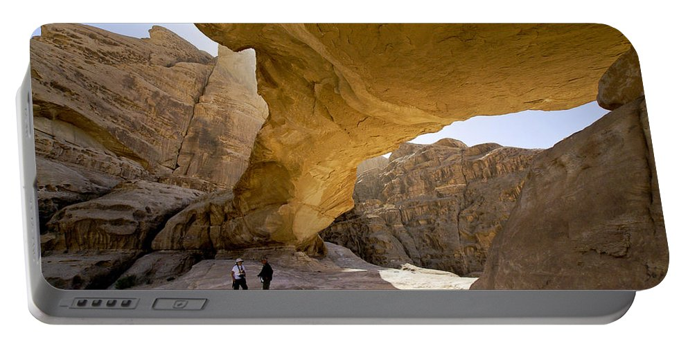 Middle East Portable Battery Charger featuring the photograph Natural Arch In Wadi Rum by Michele Burgess