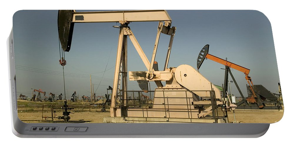 Oil Portable Battery Charger featuring the photograph Nodding Donkey Oil Pumps by Inga Spence