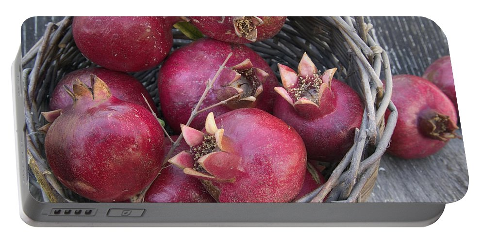 Punica Granatum Portable Battery Charger featuring the photograph Pomegranates In A Basket by Inga Spence