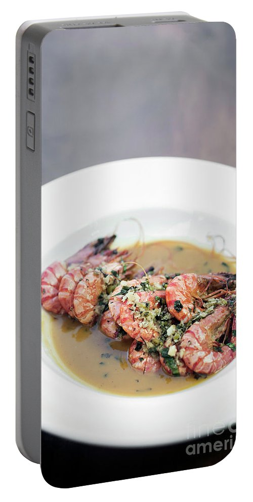 Butter Portable Battery Charger featuring the photograph Prawn Shimps In Garlic Butter Olive Oil by Jacek Malipan