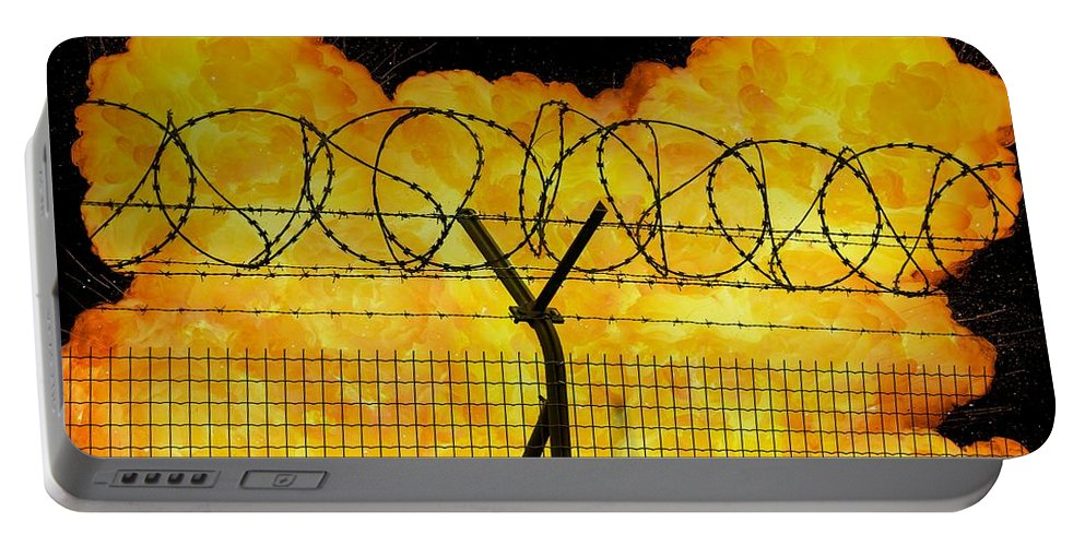 Prison Portable Battery Charger featuring the photograph Realistic Orange Fire Explosion Behind Restricted Area Barbed Wire Fence by Lukasz Szczepanski