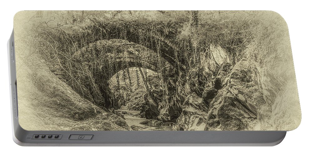 Roman Portable Battery Charger featuring the photograph Roman Bridge , Penmachno by Chris Evans
