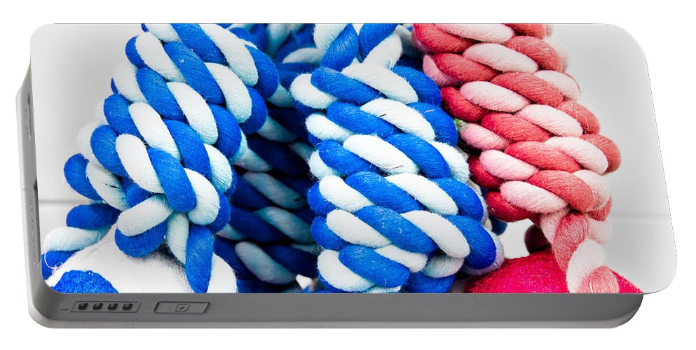Abstract Portable Battery Charger featuring the photograph Rope Toys by Tom Gowanlock