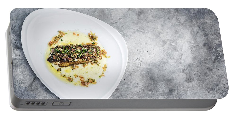Alternative Portable Battery Charger featuring the photograph Sea Bass Fish With Mexican Salsa Sauce by Jacek Malipan