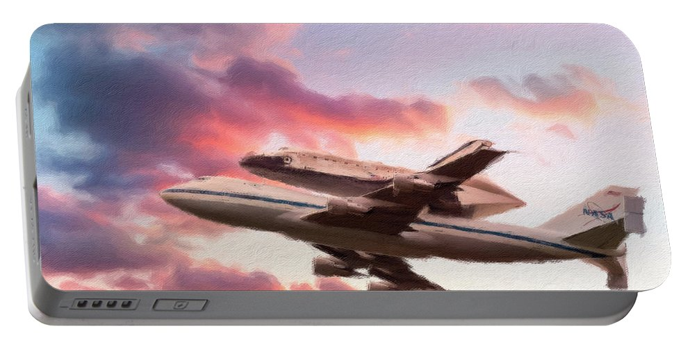 Aeroplane Portable Battery Charger featuring the photograph Space Shuttle Discovery Flies Off Into Retirement by Steven Heap