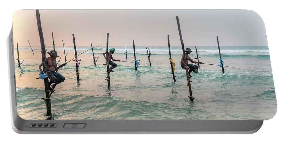 Stilt Portable Battery Charger featuring the photograph Stilt Fishermen - Sri Lanka by Joana Kruse