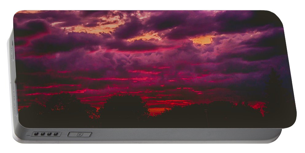 Summer Portable Battery Charger featuring the photograph Stormy Sunset by Kristin Hunt