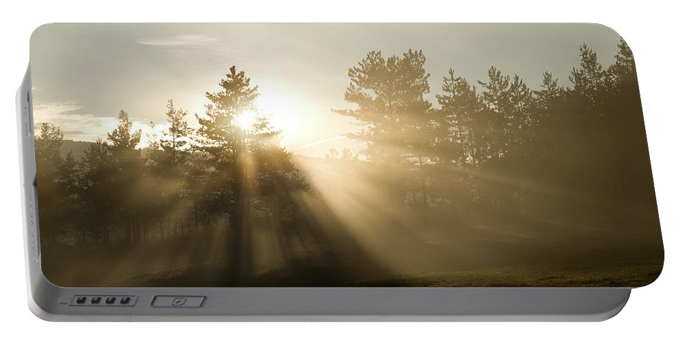 Seasonal Portable Battery Charger featuring the photograph Sunrise Bursting Through Trees And Mist At Palsko Lake by Ian Middleton