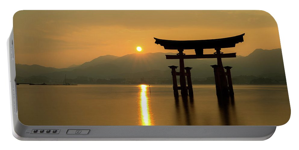 Japan Portable Battery Charger featuring the photograph Sunset At Miyajima's Torii by Sam Garcia