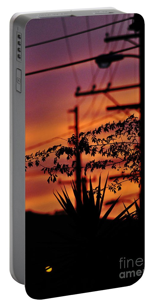 Clay Portable Battery Charger featuring the photograph Sunset Sihouettes by Clayton Bruster