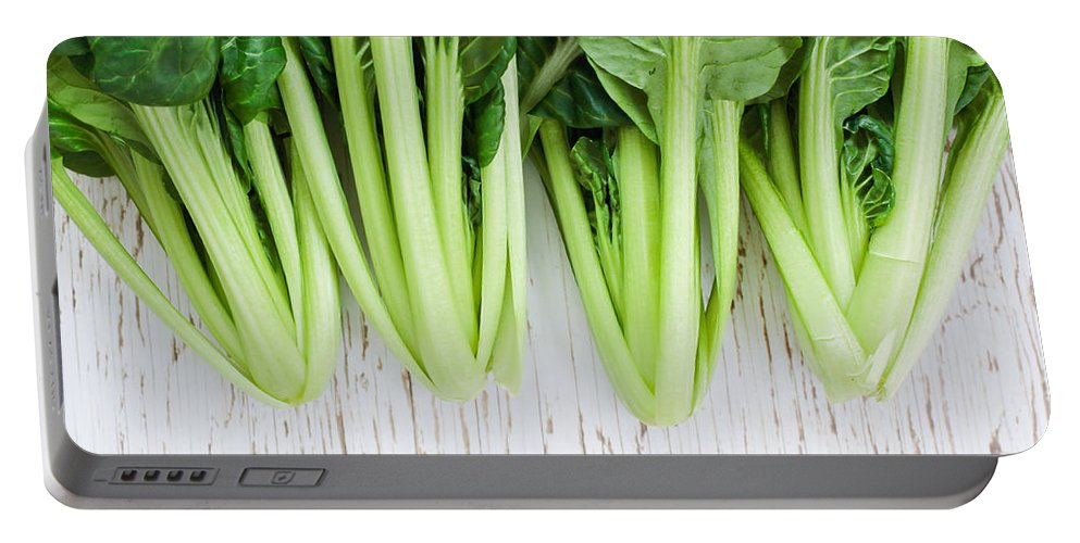 Agriculture Portable Battery Charger featuring the photograph Tatsoi by Tom Gowanlock
