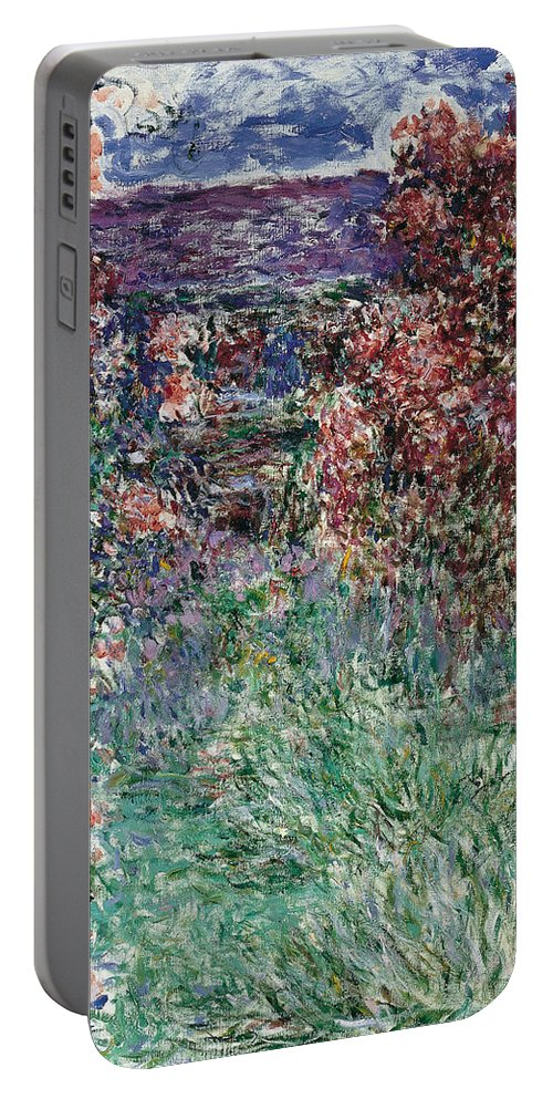 Claude Monet Portable Battery Charger featuring the painting The House Among The Roses by Claude Monet