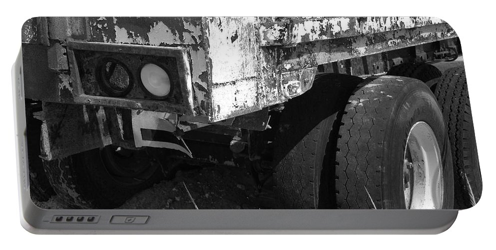 Black And White Portable Battery Charger featuring the photograph Truck Lights by Rob Hans