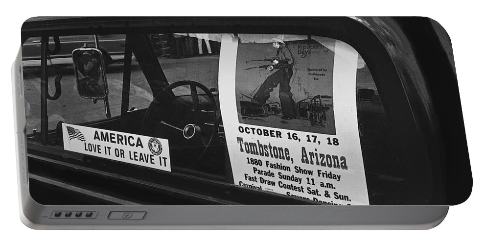 Truck With Right Wing Decal And Helldorado Days Poster Tombstone Arizona 1970 Portable Battery Charger featuring the photograph Truck With Right Wing Decal And Helldorado Days Poster Tombstone Arizona 1970 by David Lee Guss