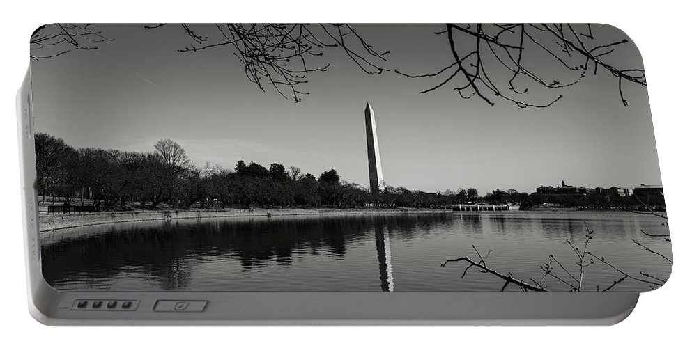 Green Portable Battery Charger featuring the photograph Washington Memorial Framed By Cherry Trees In The Winter by Brandon Bourdages