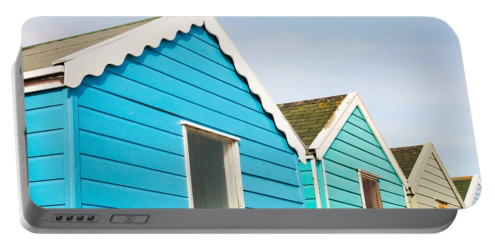 Southwold Portable Battery Charger featuring the photograph Beach Huts by Tom Gowanlock