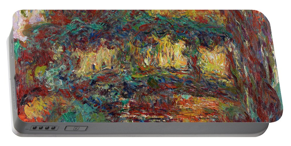 Claude Monet Portable Battery Charger featuring the painting The Japanese Bridge by Claude Monet