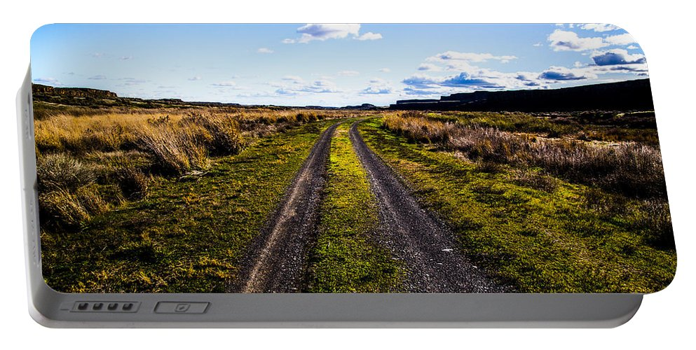 Portable Battery Charger featuring the photograph Journey Home by Angus Hooper Iii