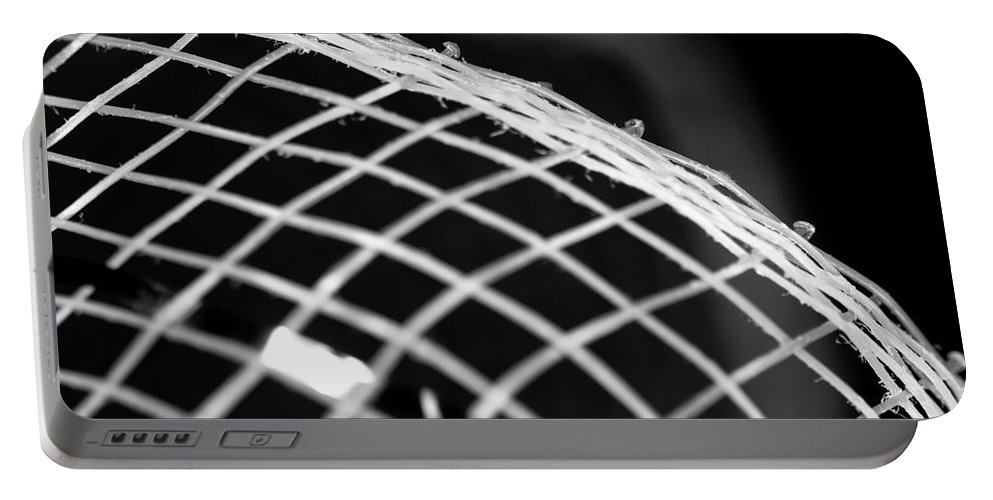 Grid Portable Battery Charger featuring the photograph Macro Of Everyday Object by Diane Schuler
