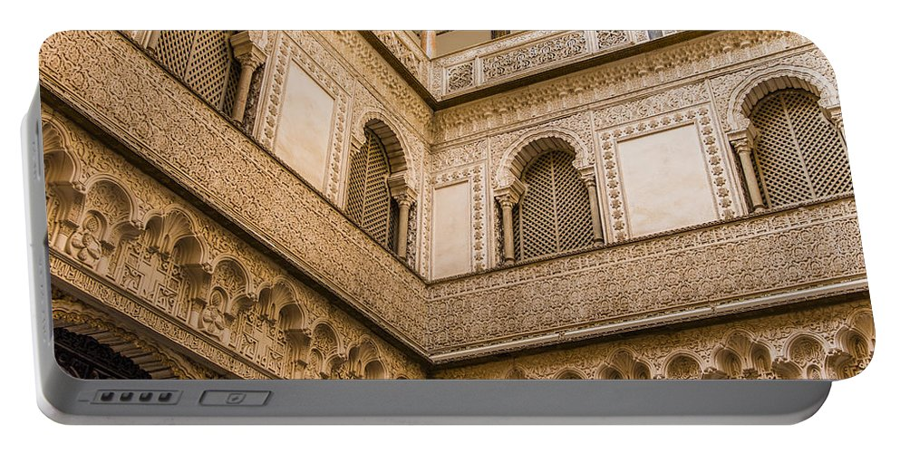 Alcazar Portable Battery Charger featuring the photograph Alcazar Of Seville - Seville Spain by Jon Berghoff